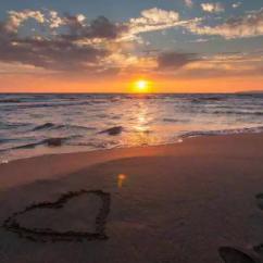 heart on beach sunset